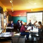 Diners Enjoying Indoor Seating and Eating Fresh Yachats Seafood at the Luna Sea Restaurant