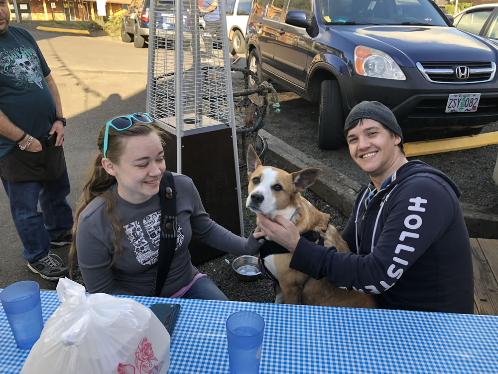 Couple With Their Dog Outside at OurPet Friendly Yachats Oregon Restaurant